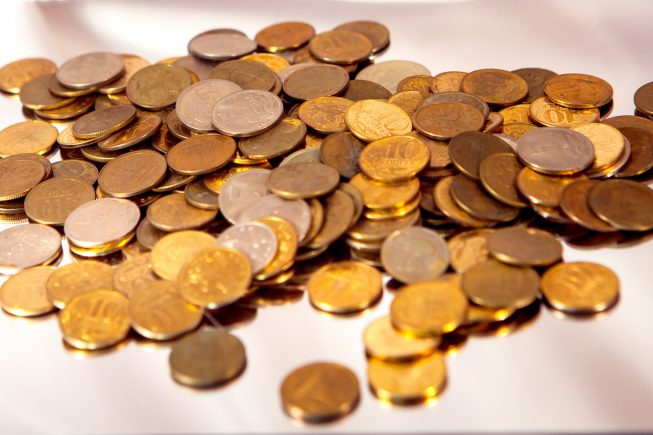 small coins scattered on the table